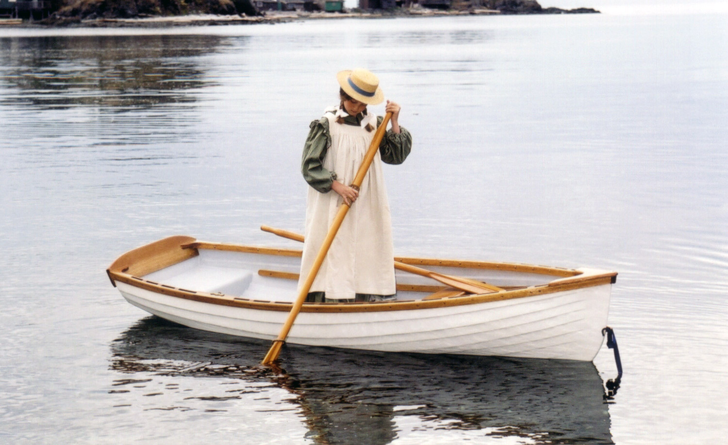Woman in yacht tender rowboat